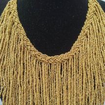 brass fringe necklace close up